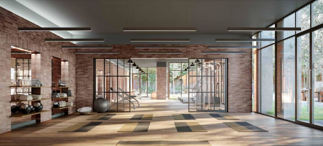 gym with exposed brick at notting hill condos
